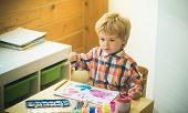 Art. Art Therapy For Children. Boy Draws Bright Picture On The Childrens Table. Cute Young Artist En poster