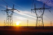 foto of electricity pylon  - Electricity pylons and sunset  - JPG