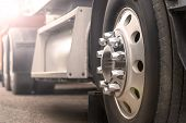 Truck Driving On Road. Truck Wheel Closeup, Transportation, Motion Blur poster