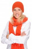 stock photo of full cheeks  - Full isolated portrait of a beautiful  caucasian smiling woman with muffler and cap - JPG