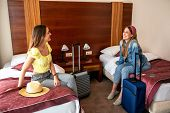 Two Pretty Girls Arriving In Their Hotel Room poster