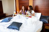 Two Pretty Girls Eating Healthy In Bed poster