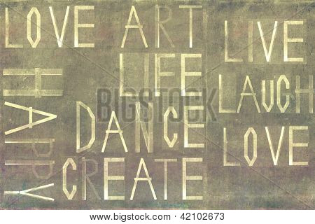 """Earthy background image and design element depicting the words """"love, life, art, happy, dance, create, live, laugh"""""""