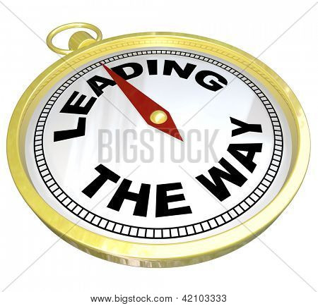 A gold compass with the words Leading the Way illustrating the forward charging path of a visionary leader who must lead his or her group through a challenge to success