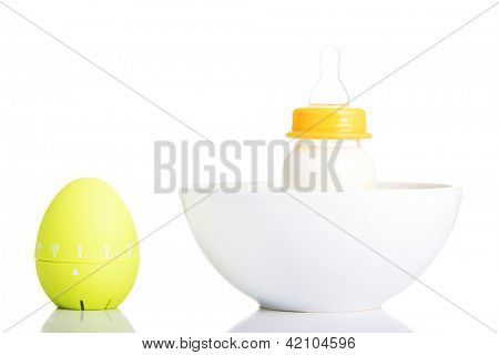 Baby milk bottle and timer close up