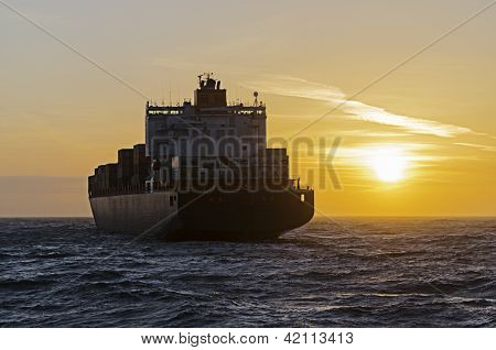 Container Ship Heading Towards Sunset