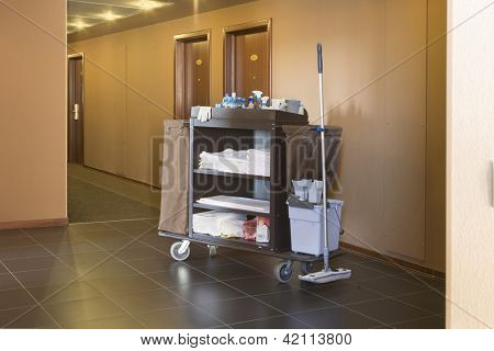 Cleaners trolley on empty floor of hotel