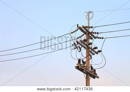 Electric pole junction current wire evening sky.