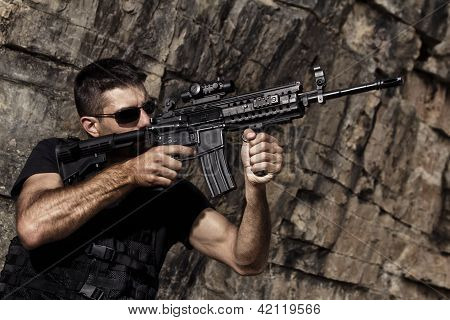 Menacing Man Pointing A Machine Gun