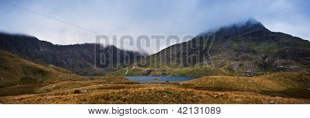 View Over Llyn Llydaw To Cloud Covered Mount Snowdon