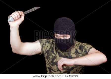 The Murderer With A Knife In A Black Mask