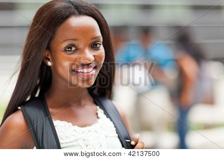 pretty female african american high school student on campus