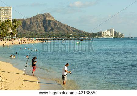 Fishermen On Busy Beach Of Waikiki