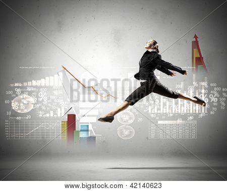 Image of pretty businesswoman jumping high against financial background