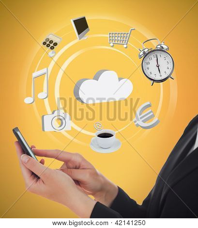 Businesswoman using applications on mobile phone on orange background