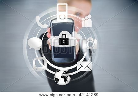Businesswoman holding up locked smart phone with applications
