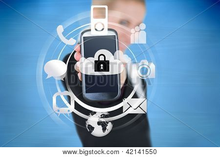 Businesswoman holding up locked smart phone with applications on blue background