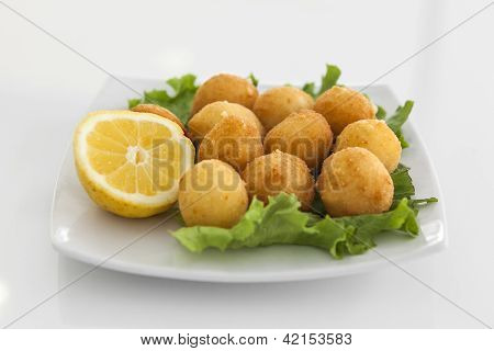 A Plate With Croquettes