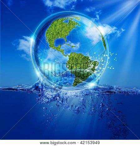Water Earth globe over ocean waves