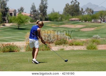Mulher golfista