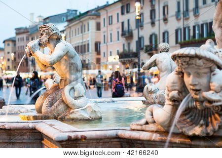 Northward view of the Piazza Navona with the fontana del Moro (the Moor Fountain) and the Sant'Agnese in Agone church at dusk - Rome, Italy