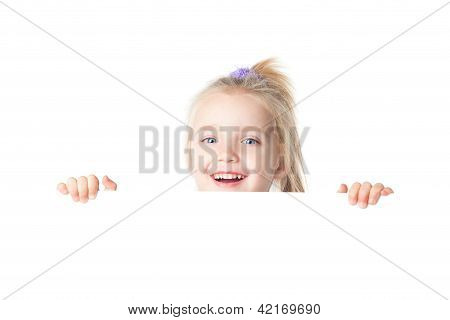 Happy Little Girl Looking Over Empty Board