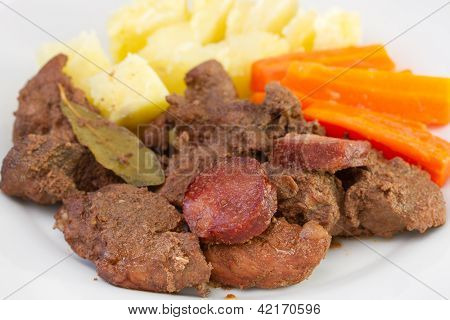 Fried Pork With Sausages And Potato