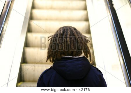 Person Going Up Escalator
