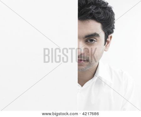 Asian Guy  Standing Behind A Blank Placard