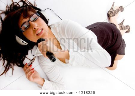 Top View Of Singing Woman Listening Music