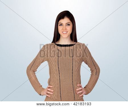 Attractive girl with her hands akimbo isolated on blue background