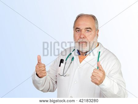 Senior doctor with hoary hair saying Ok isolated on a blue background