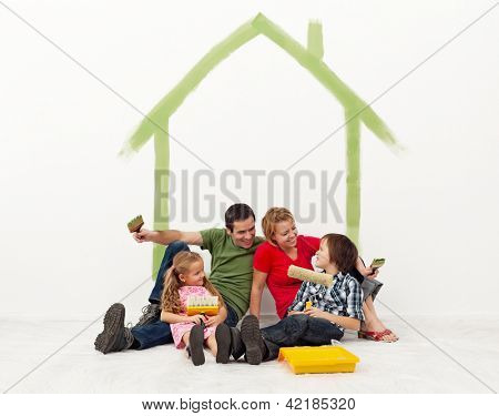 Family repainting their homewith the kids - concept