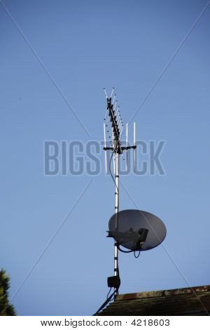 A Satellite Digital Television Dish On A Roof