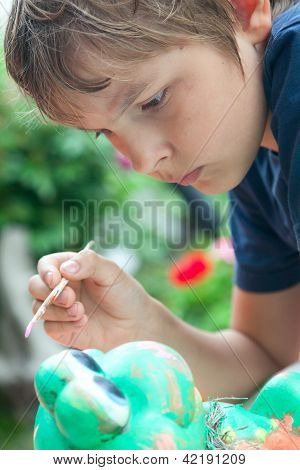 Boy Painting With A Brush