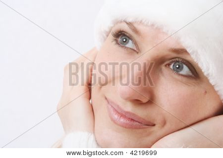 Girl Smiles In A New Year's Cap