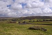 stock photo of errat  - Landscape view from Norber Erratics towards Wharfe Dale in Yorkshire Dales National Park - JPG
