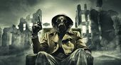 image of gases  - Post apocalyptic survivor in gas mask destroyed city in the background - JPG