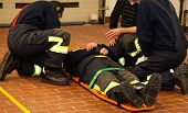 stock photo of stretcher  - Fire Rescue man with the stretcher and first aid
