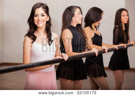 Happy ballet dancers in a barre