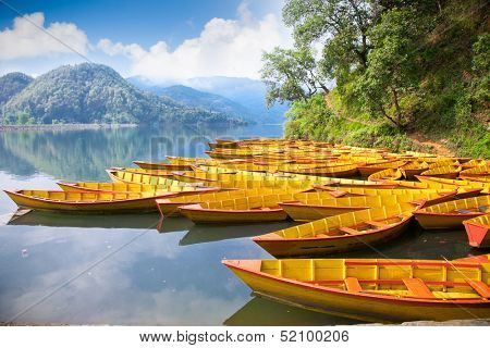 Fishing boat at Bengas lake in Pokhara , Nepal. One of the most beautiful Lakes of Pokhara Valley is the well-known Phewa Lake.