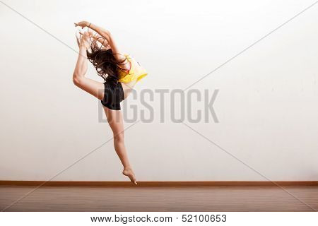 Sexy jazz dancer performing a jump