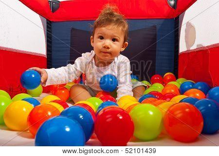 Baby In Playpen With Balls