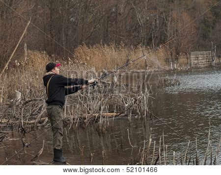 Young Angler Fishing Spinning