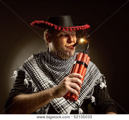 Serious cowboy mexican firing dynamite by cigar