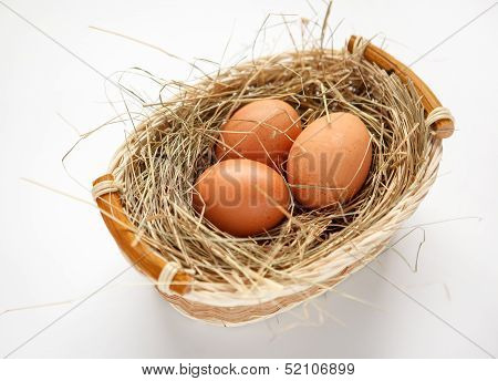 Wattled willow basket with brown chicken eggs