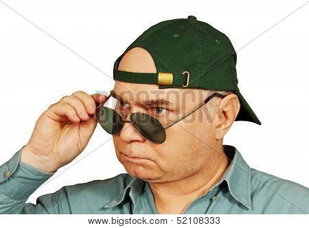 A Man In A Baseball Cap And Dark Glasses.