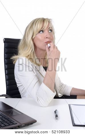 Business Woman / Secretary Painting Her Lips While Not Working