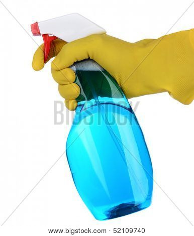 Closeup of a plastic spray bottle of cleaner being held by a hand wearing a yellow latex glove. The cleanser / chemical is blue and the persons finger is on the trigger nozzle.