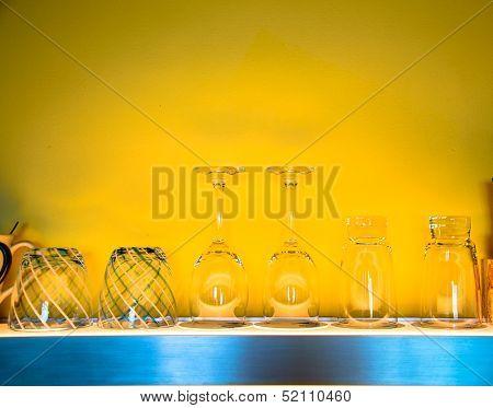 Wine Glass On Shelf With Yellow Background